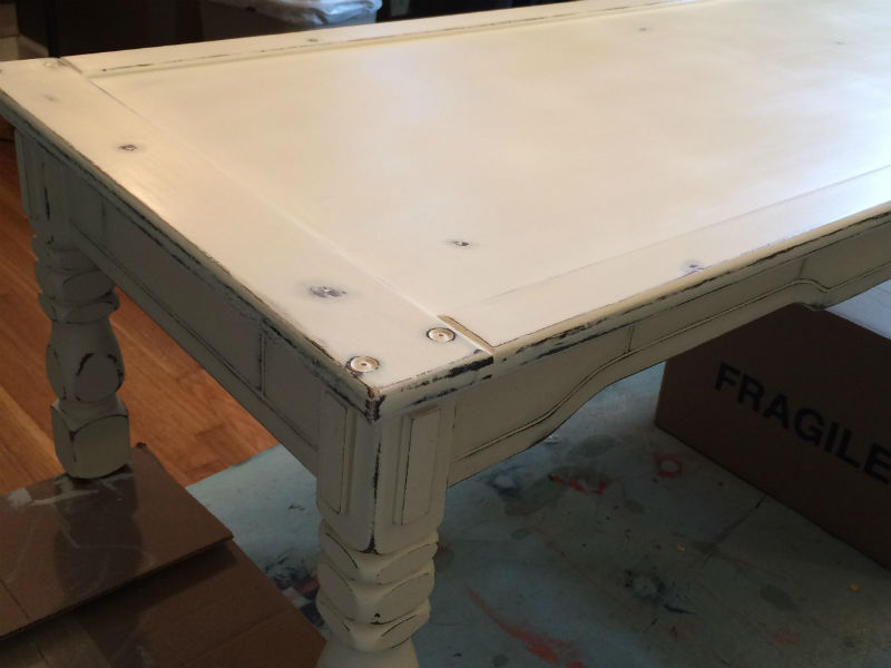 After photo of coffee table - white distressed finish.