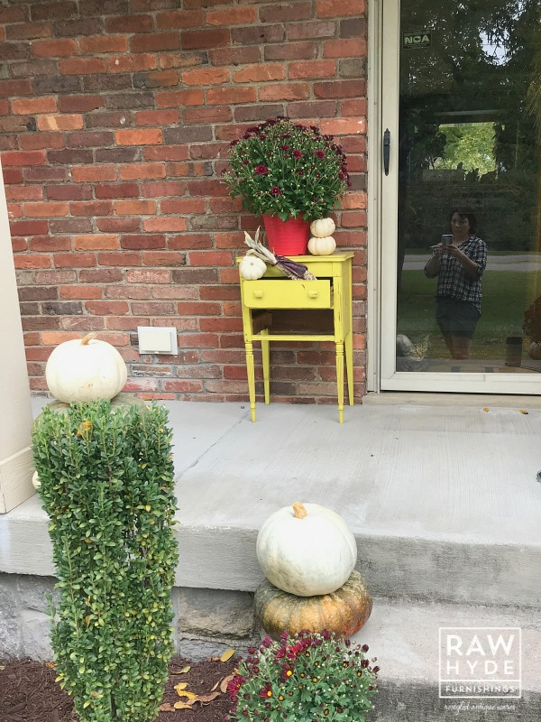 Image of the original red mum pot throwing off the overall vibe of my fall porch decor.